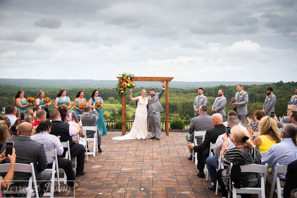 Bride, groom, and guests during a wedding at The Overlook at Geer Tree Farm in Griswold, Connecticut