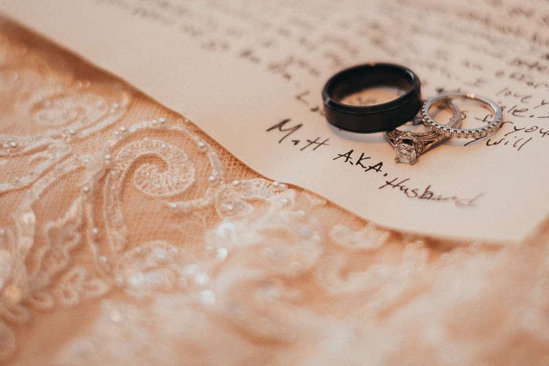 The morning of a Connecticut wedding, the bride and groom's rings, the groom's letter, and the bride's dress