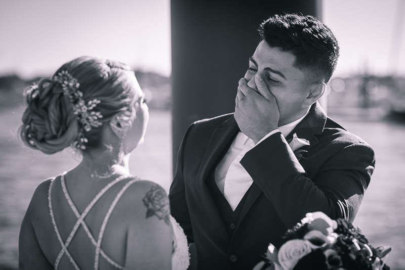 An emotional photo of a Newport, Rhode Island groom seeing his bride for the first time on their wedding day