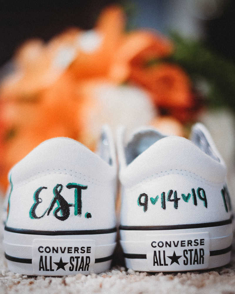 Bride's custom-painted Converse All-Stars Chuck Taylor wedding day sneakers