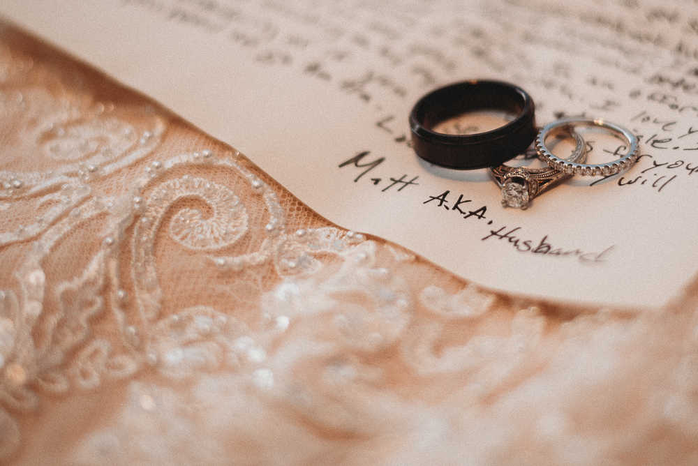 Wedding rings, the bride's dress, and a letter from the groom