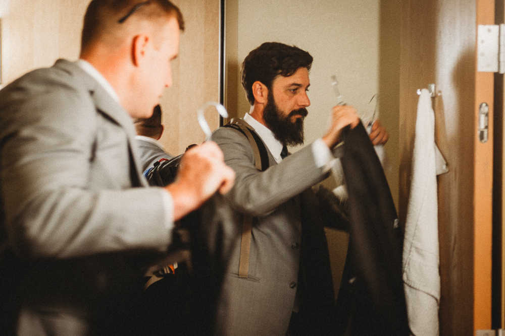 Groomsmen preparing to head out to the wedding venue