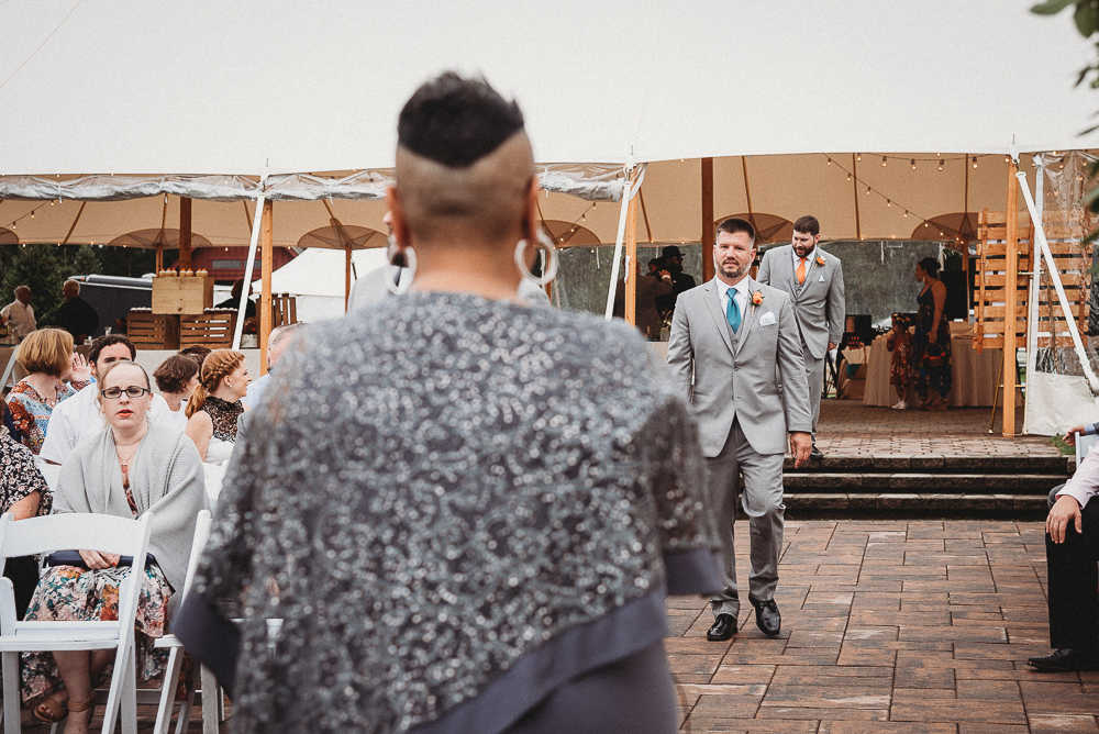 The best man walking down the aisle