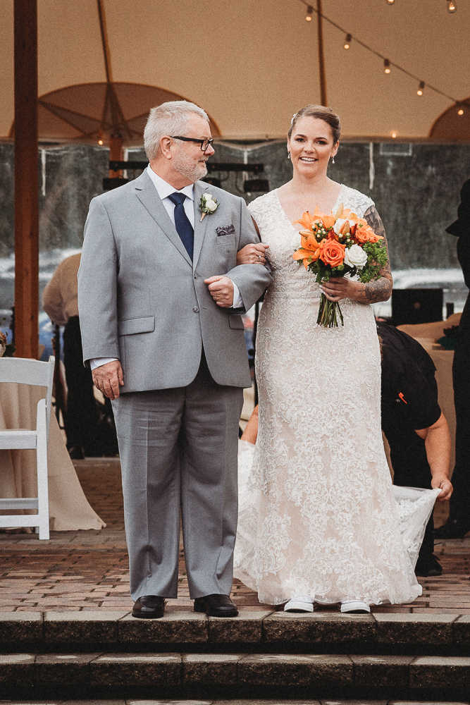 A Connecticut bride and her father walking down the aisle of a Connecticut wedding