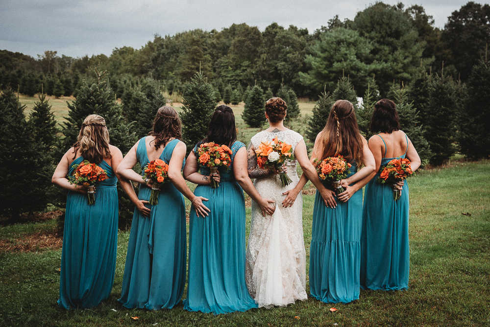 A Connecticut bride and her bridesmaids having fun at a Connecticut tree farm wedding
