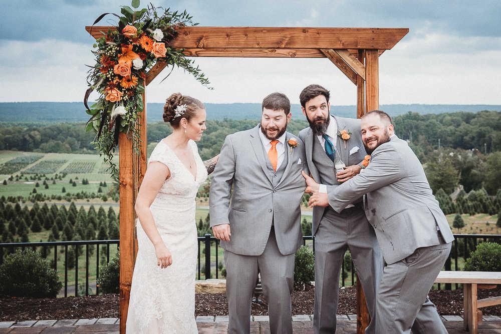 A bride, groom, and groomsmen have fun