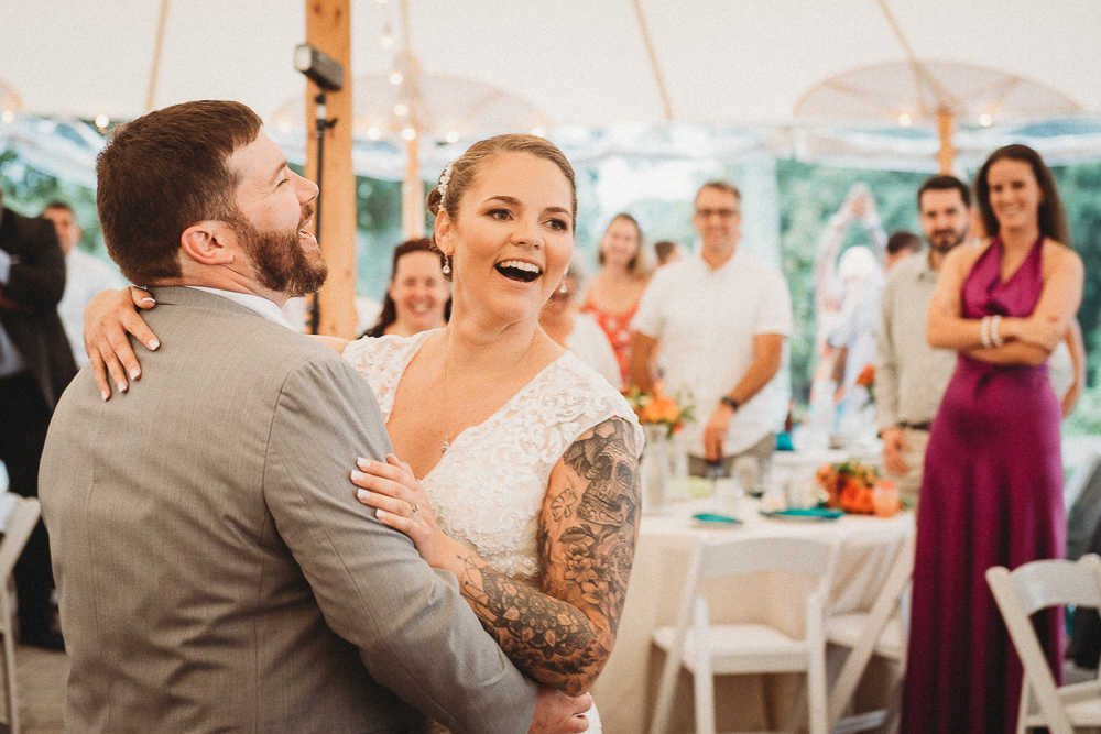 The bride and groom enjoying their first dance