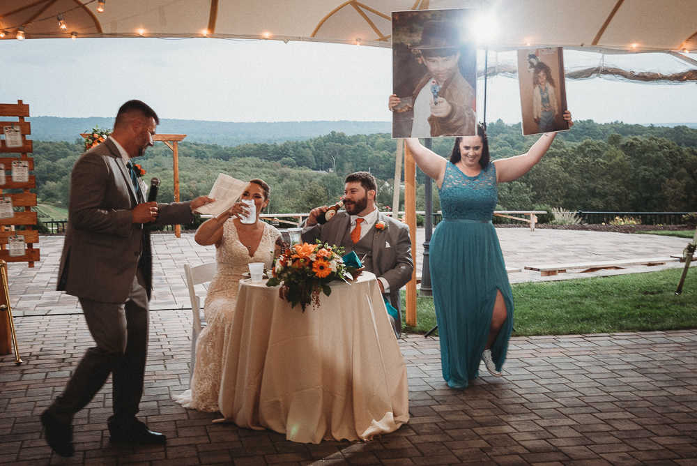 The maid of honor and best man deliver their speeches to a Connecticut bride and groom