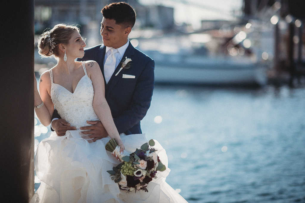Bride and groom on a Newport, Rhode Island dock during a wedding day first look