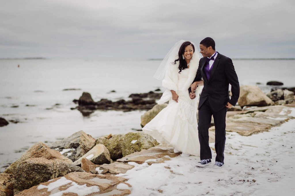 A photo of a just-married bride and groom in Stonington, CT by Connecticut wedding photographer Terrence Irving.